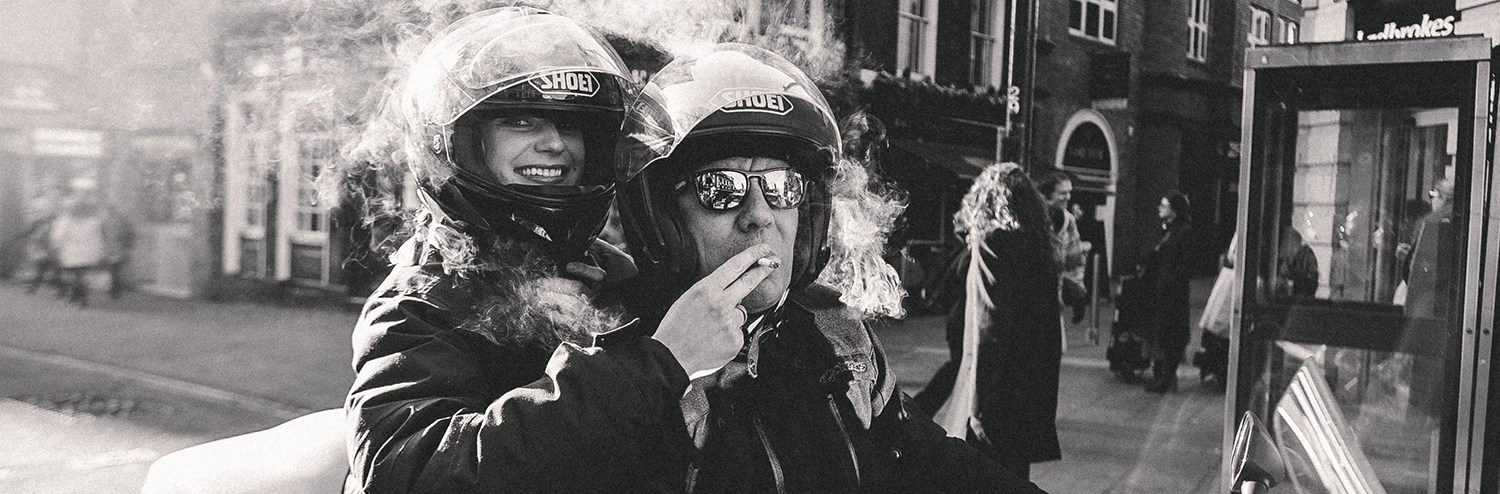 Man-And-Woman-Smoking-On-Motorbike